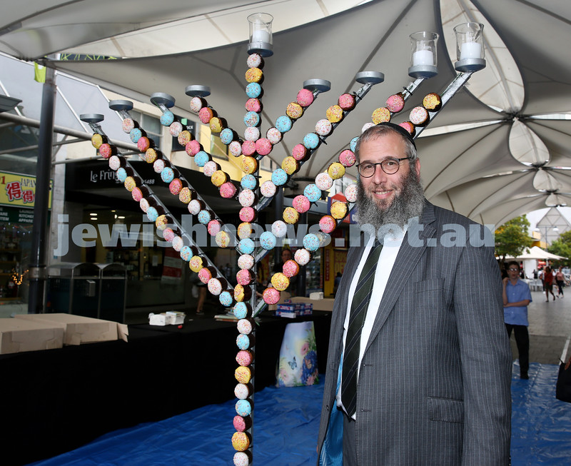 Jewish House Chanukah Party in Bondi Junction Mall. Rabbi Mendel Kastel next to the giant cupcake Menorah. Pic Noel Kessel.