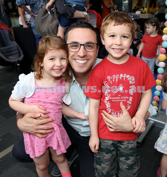 Jewish House Chanukah Party in Bondi Junction Mall. Michael Misrachi with his children Maayan (left) & Eitan (right). Pic Noel Kessel.