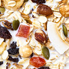 Background of premium fruit and nut muesli with milk from above.