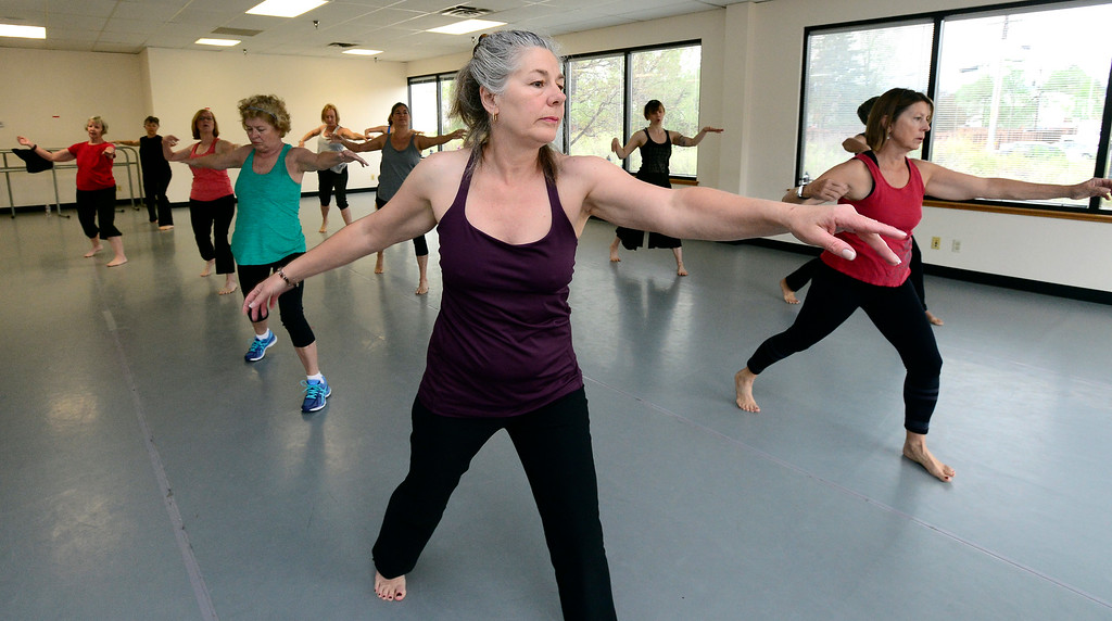 . Dawn Petersen concentrates on the footwork in Jill Factor\'s Classic Nia Class at Kinesis Dance in Boulder on Tuesday. For more photos go to www.dailycamera.com  Paul Aiken Staff Photographer May 9, 2017