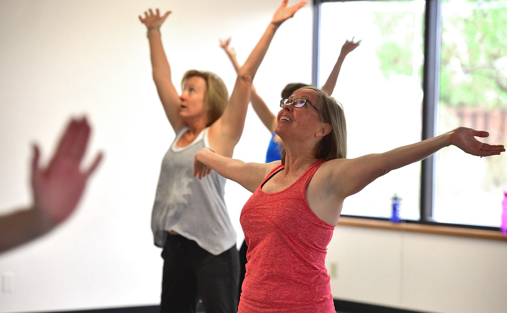 . Peggy Karr enjoys a stretching move in Jill Factor\'s Classic Nia Class at Kinesis Dance in Boulder on Tuesday. For more photos go to www.dailycamera.com  Paul Aiken Staff Photographer May 9, 2017