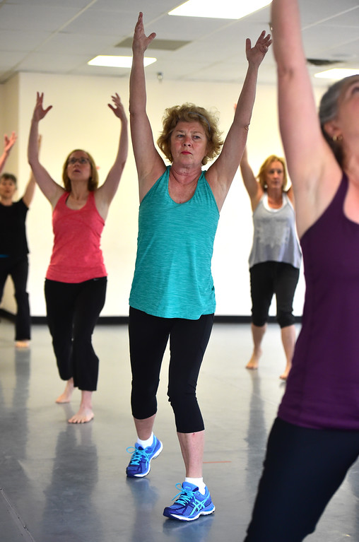 . Tina Held works in a raised arm stance in Jill Factor\'s Classic Nia Class at Kinesis Dance in Boulder on Tuesday. For more photos go to www.dailycamera.com  Paul Aiken Staff Photographer May 9, 2017