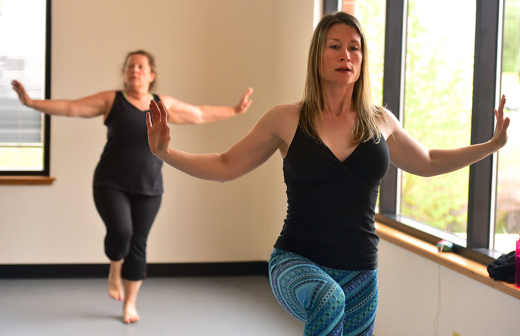 . Charlotte Mulloy  works on a balance move in Jill Factor\'s Classic Nia Class at Kinesis Dance in Boulder on Tuesday. For more photos go to www.dailycamera.com  Paul Aiken Staff Photographer May 9, 2017