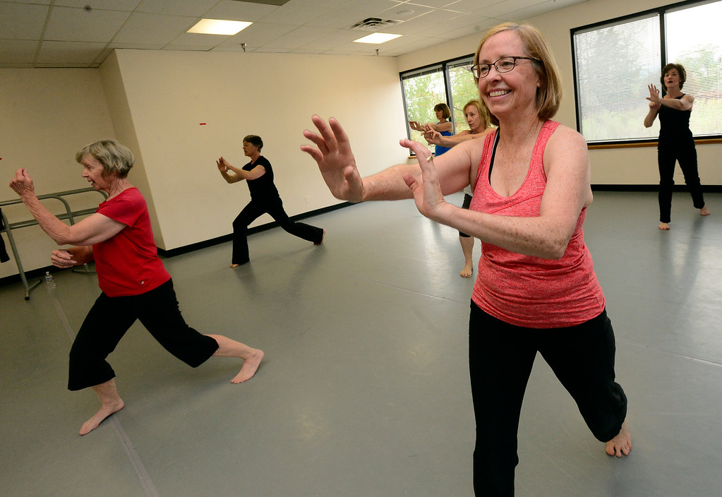 . Peggy Karr enjoys a martial arts like move in Jill Factor\'s Classic Nia Class at Kinesis Dance in Boulder on Tuesday. For more photos go to www.dailycamera.com  Paul Aiken Staff Photographer May 9, 2017