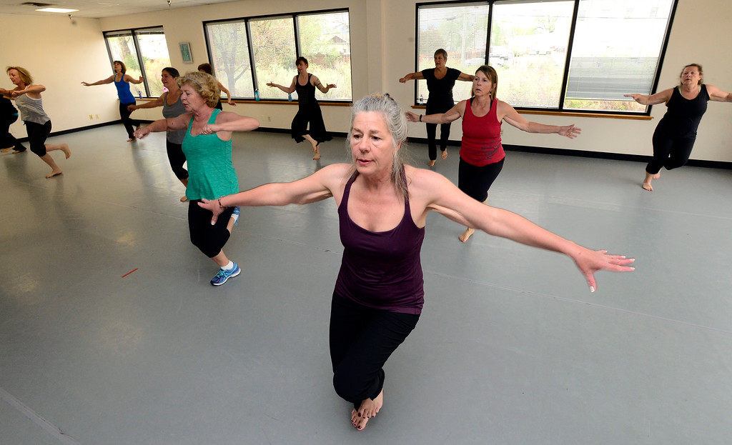 . Dawn Petersen concentrates on the footwork and balance in Jill Factor\'s Classic Nia Class at Kinesis Dance in Boulder on Tuesday. For more photos go to www.dailycamera.com  Paul Aiken Staff Photographer May 9, 2017
