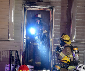 A South Windsor firefighter emerges from the house  after firefighters entered the house once the heavy fire was knocked down,  Sunday, January 15, 2017, on Griffin Road in South Windsor. The fire was reported just before 8pm by a neighbor. The fire destroyed the two-story home, no one was injured but there were reports of pets possibly in the home. (Jim Michaud / Journal Inquirer)