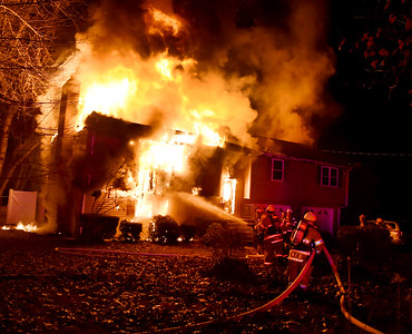 South Windsor firefighters hit the house with the first supply of water as fire engulfs a home, Sunday, January 15, 2017, on Griffin Road in South Windsor. The fire was reported just before 8pm by a neighbor. The fire destroyed the two-story home, no one was injured but there were reports of pets possibly in the home. (Jim Michaud / Journal Inquirer)