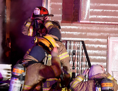 South Windsor firefighters get ready to enter the burning house after the heavy fire was knocked down, Sunday, January 15, 2017, on Griffin Road in South Windsor. The fire was reported just before 8pm by a neighbor. The fire destroyed the two-story home, no one was injured but there were reports of pets possibly in the home. (Jim Michaud / Journal Inquirer)