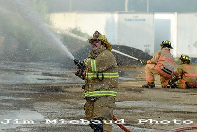 Firefighters pour water on a barn that was destroyed during a two-alarm fire, Wednesday, Sept. 12, 2019, Pleasant View Farms on South Road in Somers. The fire came in just after 4:30 about a possible fire in a barn. When the Somers Fire Department arrived nothing was visible and they needed directions to find the barn. While the fire trucks were just arriving the barn was quickly engulfed in flames leading to a second alarm being requested. Fire departments from Ellington, Stafford, East Windsor and Enfield assisted the Somers fire department. No injuries were reported. (Jim Michaud / Journal Inquirer)