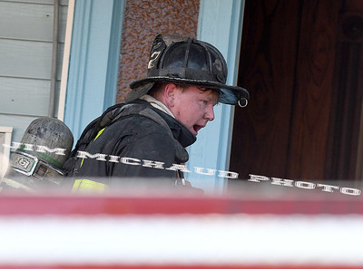 BOSTON JULY 21: A Boston firefighters takes a break on the porch of the fire building in the 95 degree heat battling a 5-alarm fire on Quincy Street in Dorchester, Sunday, July 21, 2019, in Roxbury. (Jim Michaud / MediaNews Group/Boston Herald)