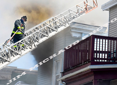 BOSTON JULY 21: Boston firefighters struggled in the 95 degree heat battling a 5-alarm fire on Quincy Street in Dorchester, Sunday, July 21, 2019, in Roxbury. (Jim Michaud / MediaNews Group/Boston Herald)