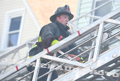 BOSTON JULY 21: A Boston stops and takes a break on his ladder truck due firefighter takes a break as firefighters struggled in the 95 degree heat fighting a 5-alarm fire on Quincy Street in Dorchester, Sunday, July 21, 2019, in Roxbury. (Jim Michaud / MediaNews Group/Boston Herald)