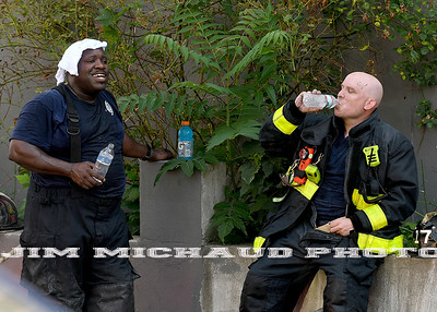 BOSTON JULY 21:  Boston first due firefighters, cool off water as firefighters struggled in the 95 degree heat fighting a 5-alarm fire on Quincy Street in Dorchester, Sunday, July 21, 2019, in Roxbury. (Jim Michaud / MediaNews Group/Boston Herald)