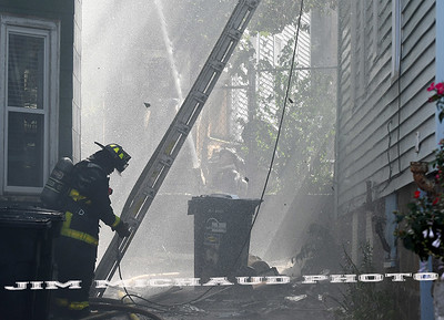 BOSTON JULY 21: Boston firefighters struggled in the 95 degree heat battling a 5-alarm fire on Quincy Street in Dorchester, Sunday, July 21, 2019, in Roxbury. (Jim Michaud / MediaNews Group/Boston Herald)