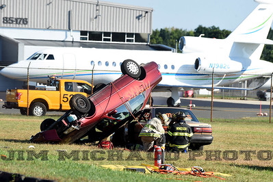 As part of the drill, the plane crashed caused a multi-car accident, Saturday, Sept. 29, 2018, in Windsor Locks. WVIT-TV reports the mass casualty exercise involved more than 25 mutual aid agencies at the local, state and federal level and about 100 actors. The Federal Aviation Administration requires the drill every three years. The plane in the background was not part of the exercise. (Jim Michaud / Journal Inquirer)