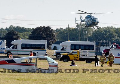 As part of the drill, a Life Star helicopter lands to transport a critically injured, Saturday, Sept. 29, 2018, in Windsor Locks. WVIT-TV reports the mass casualty exercise involved more than 25 mutual aid agencies at the local, state and federal level and about 100 actors. The Federal Aviation Administration requires the drill every three years. The plane in the background was not part of the exercise. (Jim Michaud / Journal Inquirer)