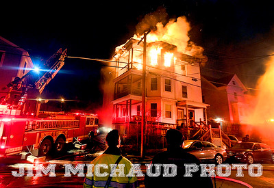 LYNN MA NOVEMBER 22: Lynn firefighter battle a three-alarm-fire on Grover Street, Thursday night, November 22, 2018, in Lynn. (Herald Photo by Jim Michaud)