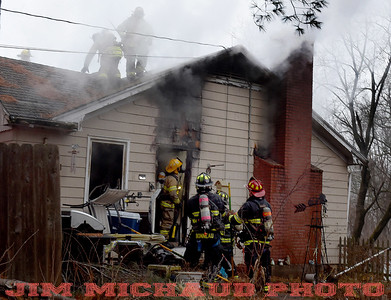 South Windsor firefighters work at a house fire, Tuesday, January 8, 2019, in South Windsor. The fire came in around 4pm at 234 Long Hill Road when a passing motorist noticed smoke coming from the house. Three dogs escaped when police arrived and the open the door. The three cats were removed by firefighters, 2 responded quickly to the oxygen they were given a third seemed to be unconscious as firefighters continued to work on him. The house sustained heavy damage to the kitchen and living room, the area around a wood stove sustained the heaviest damage, Chief Kevin Cooney said. The house was deemed uninhabitable and the residents are staying with other family members Cooney said. (Jim Michaud / Journal Inquirer)