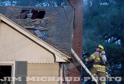 A South Windsor firefighter work looking for hot spots during a burning house fire, Tuesday, January 8, 2019, in South Windsor. The fire came in around 4pm at 234 Long Hill Road when a passing motorist noticed smoke coming from the house. Three dogs escaped when police arrived and opened the door. The three cats were removed by firefighters, 2 responded quickly to the oxygen they were given a third seemed to be unconscious as firefighters continued to work on him. The house sustained heavy damage to the kitchen and living room, the area around a wood stove sustained the heaviest damage, Chief Kevin Cooney said. The house was deemed uninhabitable and the residents are staying with other family members Cooney said. (Jim Michaud / Journal Inquirer)