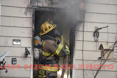 A South Windsor firefighter works at a house fire, Tuesday, January 8, 2019, in South Windsor. The fire came in around 4pm at 234 Long Hill Road when a passing motorist noticed smoke coming from the house. Three dogs escaped when police arrived and opened the door. The three cats were removed by firefighters, 2 responded quickly to the oxygen they were given a third seemed to be unconscious as firefighters continued to work on him. The house sustained heavy damage to the kitchen and living room, the area around a wood stove sustained the heaviest damage, Chief Kevin Cooney said. The house was deemed uninhabitable and the residents are staying with other family members Cooney said. (Jim Michaud / Journal Inquirer)