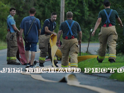 as the South Windsor firefighter department does a drill, Tuesday, July 24, 2018, in South Windsor. The drill took place on Niederwerfer Road where fire hydrants only cover part of the area. Fire firefighters laid 5 inch large diameter hose called a supply line. That line feeds water to the fire engines during a fire. Firefighters had to lay over 1,500 feet of supply line off of their brand new engine 6 that has not gone into service yet. (Jim Michaud / Journal Inquirer)