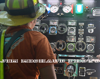Firefighter Dan Dzen operates the pump panel as the South Windsor firefighter department does a drill, Tuesday, July 24, 2018, in South Windsor. The drill took place on Niederwerfer Road where fire hydrants only cover part of the area. Fire firefighters laid 5 inch large diameter hose called a supply line. That line feeds water to the fire engines during a fire. Firefighters had to lay over 1,500 feet of supply line off of their brand new engine 6 that has not gone into service yet. (Jim Michaud / Journal Inquirer)