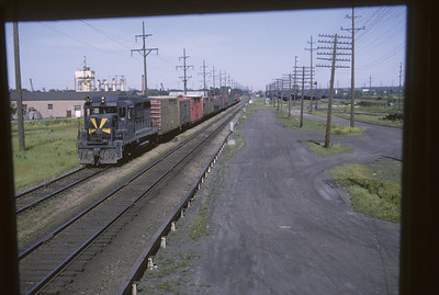 2016.020.17.15--jim neubauer 35mm kodachrome--B&O--EMD diesel locomotive 6960 on freight transfer train on ICRR as seen from interlocking tower--Chicago IL--1965 0600