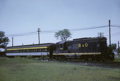 2016.020.17.18--jim neubauer 35mm kodachrome--B&O--EMD diesel locomotive 6604 with Haswell Special passenger fantrip--Deshler OH--1967 0600