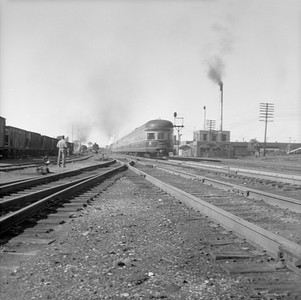 2016.020.99.066--jim neubauer 120 neg--B&O--obs-lounge car on hind end of The Cincinnatian passenger train scene--location unknown--c1950 0000