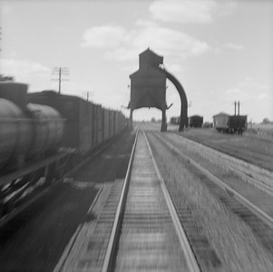 2016.020.99.067--jim neubauer 120 neg--B&O--view of coal chute from rear of Railroad Club of Chicago fantrip at speed--Deshler OH--1950 0820