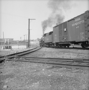 2016.020.99.147--jim neubauer 120 neg--C&NW--steam locomotive 0-6-0 M-3 2624 with freight cars action--location unknown--c1951 0000