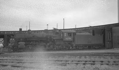 2016.020.99.129--jim neubauer 116 neg--C&NW--steam locomotive 4-6-2 E-1 2218 used as steam source for heating at roundhouse--Milwaukee WI--1954 0912