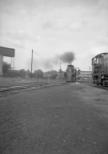 2016.020.99.207--jim neubauer 6x9 neg--GTW--steam locomotive 4-8-4 U-4-b 6408 with Inter City Ltd passenger train 17 arriving--Battle Creek MI--1950 0716