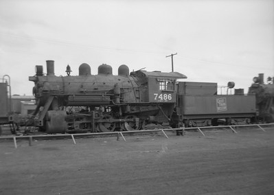 2016.020.99.200--jim neubauer 6x9 neg--GTW--steam locomotive 0-6-0 O-18-b 7486 (dead)--Battle Creek MI--1950 0716