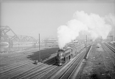 2016.020.98.099--jim neubauer 828 neg--GTW--steam locomotive on passenger train at 16th Street departing action--Chicago IL--c1951 0000