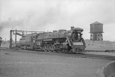 2016.020.98.064--jim neubauer 828 neg--CNR--steam locomotive 4-8-4 U-2-c 6154 taking water--location unknown--c1952 0000