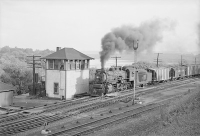 2016.020.98.059--jim neubauer 828 neg--CNR--steam locomotive 2-8-0 N-2-b 2506 on freight train action passing interlocking tower--Bayview ON--c1952 0000