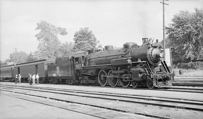 2016.020.99.005--jim neubauer 116 neg [John Mateka]--GTW--steam locomotive 4-6-2 K-4-a 5627 on passenger train--location unknown--c1952 0000