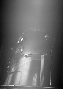2016.020.99.201--jim neubauer 6x9 neg--GTW--steam locomotive 4-8-4 U-4-b 6407 in shops--Battle Creek MI--1950 0716