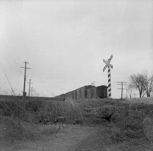 2016.020.99.027--jim neubauer 120 neg--CMStP&P--caboose on hind end of freight train--location unknown--c1952 0000