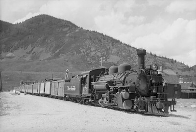 2016.020.98.235--jim neubauer 828 neg--D&RGW--The Silverton arrived with steam locomotive 2-8-2 K-28 276--Silverton CO--c1952 0000