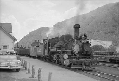 2016.020.98.239--jim neubauer 828 neg--D&RGW--The Silverton ready for departure with steam locomotive 2-8-2 K-28 478 at depot--Durango CO--c1952 0000