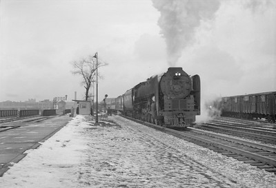 2016.020.98.115--jim neubauer 828 neg--NYC--steam locomotive 4-8-4 S1b 6015 on passenger train The Pacemaker 15 cars--Englewood IL--1953 0118