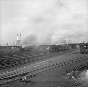 2016.020.99.159--jim neubauer 120 neg--NYC--steam locomotive switching passenger cars scene at Roosevelt Road--Chicago IL--c1950 0000