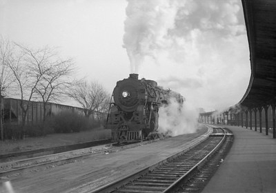 2016.020.98.323--jim neubauer 828 neg--NYC--steam locomotive 4-6-4 J1d 5292 on passenger train at station platform--Englewood IL--c1952 0000