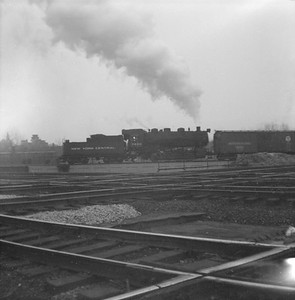 2016.020.99.024--jim neubauer 120 neg--NYC--steam locomotive 0-6-0 U3b 7650 shoving freight cars on wye--Joliet IL--c1952 0000