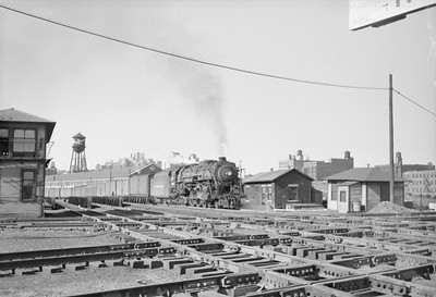 2016.020.98.132--jim neubauer 828 neg--NYC--steam locomotive 4-6-4 crossing interlocking plant at Air Line crossing with passenger train--Chicago IL--c1952 000
