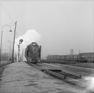 2016.020.99.080--jim neubauer 120 neg--NYC--steam locomotive 4-8-4 6025 on train at speed action--Englewood IL--c1951 0000