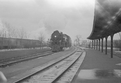 2016.020.98.110--jim neubauer 828 neg-- NYC--steam locomotive 4-6-4 J3a 5410 with 13-car passenger train--Englewood IL--1953 0118