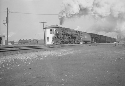 2016.020.98.126--jim neubauer 828 neg--NYC--steam locomotive 4-6-4 J1d 5288 5466 doubleheader on passenger train 14 at 16th Street interlocking tower--Chicago IL--1953 0223